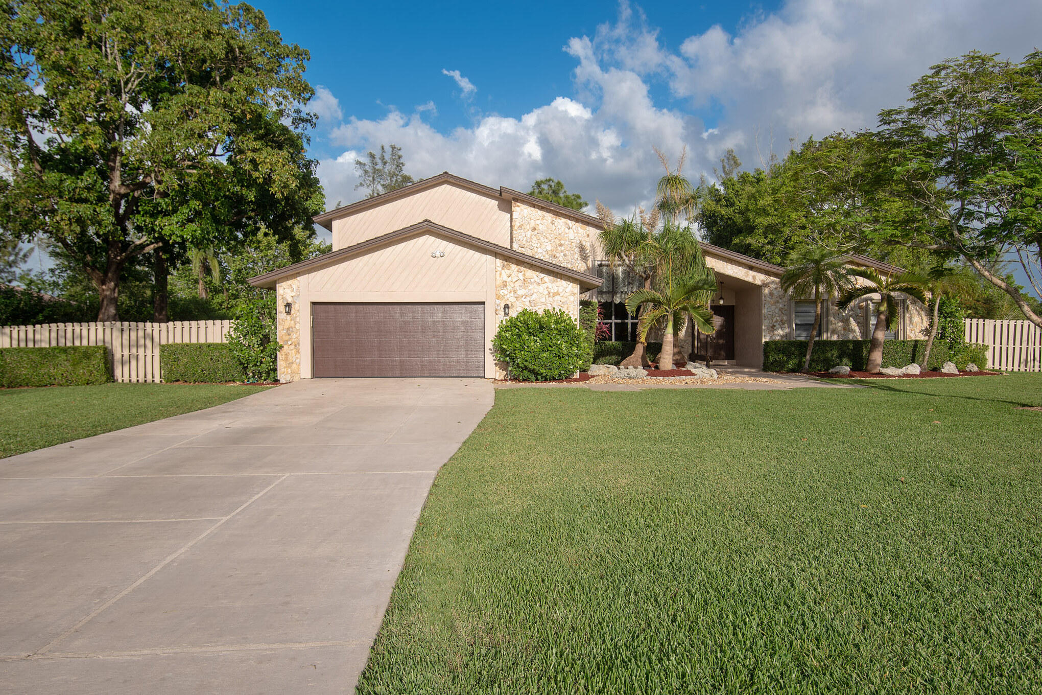 Rare opportunity to live on over 1 acre in the beautiful West Boca neighborhood of Tamarron in Logger's Run. This one of a kind 4 bedroom 2.5 bathroom home has tons of space, lots of light, a huge 2nd story master suite with a spacious master bath and walk-in closet, fireplace, hurricane shutters and a bonus/sun room leading out to a private pool and giant backyard and patio for entertaining. Close to parks, shopping, and top rated schools including Water's Edge Elementary.