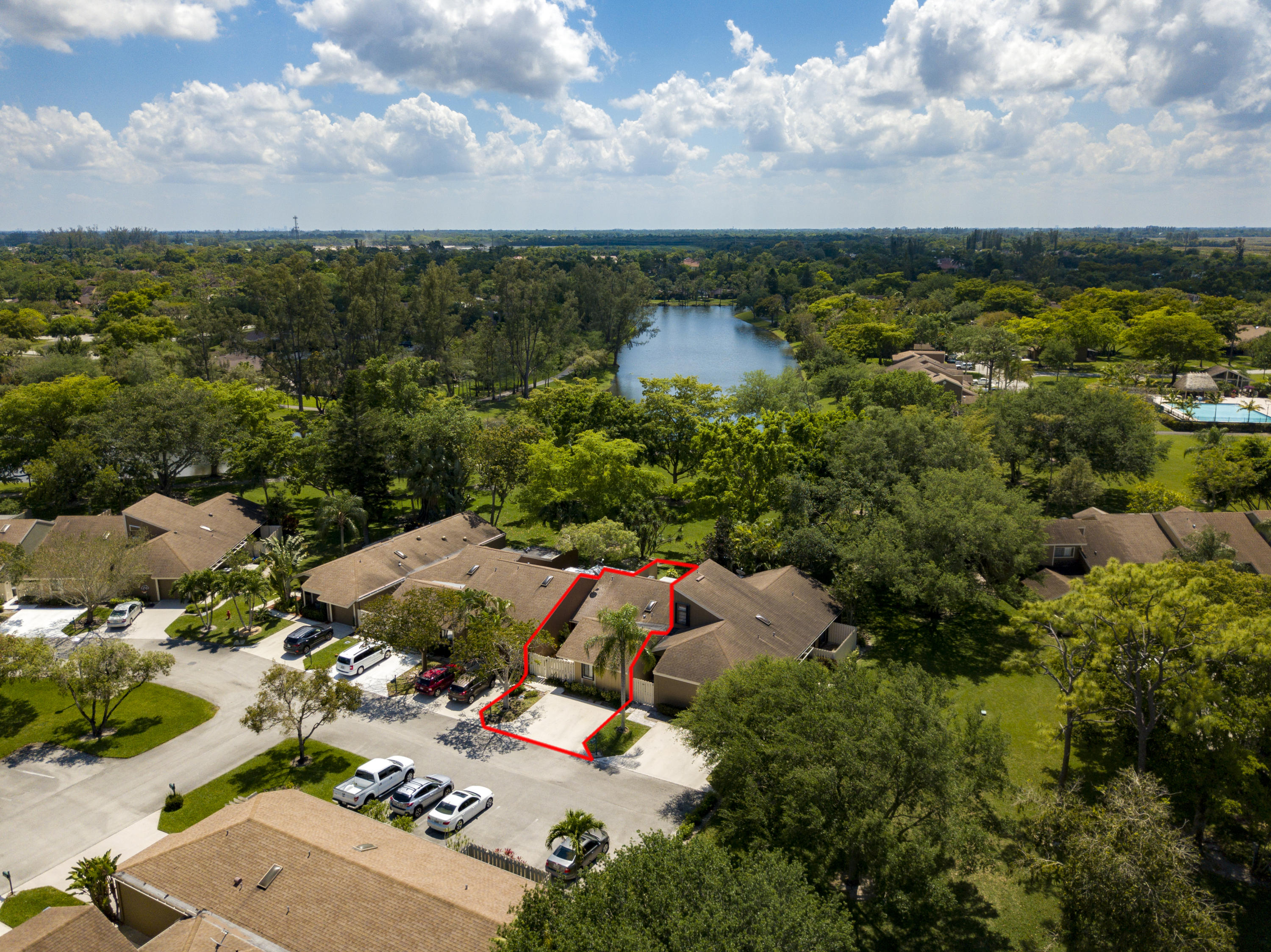 Don't miss out on a great opportunity to get into great A+ rated school district for the 2019-2020 school year.  This 3 Bedroom 2 Bath Villa is located in the Lush/Plush Timberwalk II within Loggers Run.  Loggers run is nestled into the South West corner of Boca Raton.  Light traffic count, shopping close by, 2 neighborhood parks and one regional park close by with Golf, Dog Parks, Amphitheater and Water park.  This villa provides a private entry area, Vaulted ceilings, Hurricane According shutters, enclosed back patio perfect for an office or play area for kids.  Located in a very private area of the community. The back yard is vast with green space, overlooks the lake and jogging path, Walking distance to the recently renovated community pool.  You will love it!