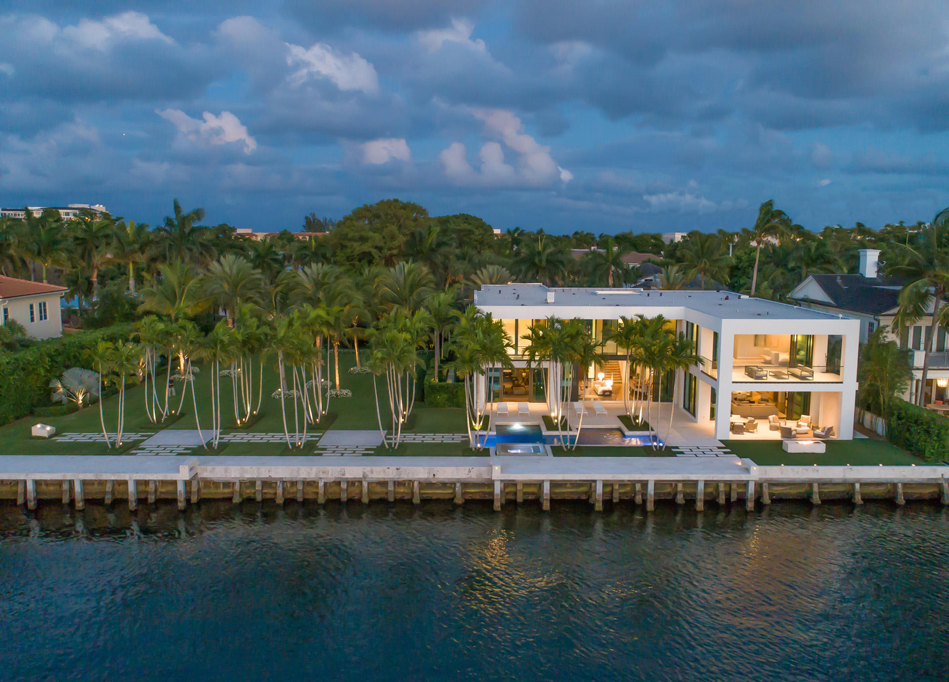 """Museum Modern Intracoastal Estate sited on two prized waterfront lots (200+/- ft) in Old Boca Raton's ''Estate Section'' originally built  (2015) by high-end builder J.H. Norman, innovative architect George Brewer and award winning Marc-Michael's Interior Design.High impact Architectural design encased in glass, stone and organic/earthy wood detailing.Resort-style pool/patio with lush landscape park-like grounds for large gatherings.Shown to pre-qualified buyers only. DISCLAIMER: The written and verbal information provided including but not limited to prices, measurements, square footages, lot sizes, calculations and statistics have been obtained and conveyed from third parties such as the applicable Multiple Listing Service, public records as well as other sources. All information including that produced by the Sellers or Listing Company are subject to errors, omissions or changes without notice and should be independently verified by any prospect for the purchase of a Property.  The Sellers and Listing Company expressly disclaim any warranty or representation regarding all information.  Prospective purchasers' use of this or any written and verbal information is acknowledgement of this disclaimer and that Prospects shall perform their own due diligence.  Prospective purchasers shall not rely on any written or verbal information provided when entering a contract for sale and purchase.  Some affiliations may not be applicable to certain geographic areas. If your property is currently listed, please do not consider this a solicitation. In the event a Buyer defaults, no commission will be paid to either Broker on the Deposits retained by the Seller.  """"No Commissions Paid until Title Passes.""""  Copyright 2019 Listing Company. All Rights Reserved."""