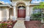 Roman Columns on front porch with Double entry way