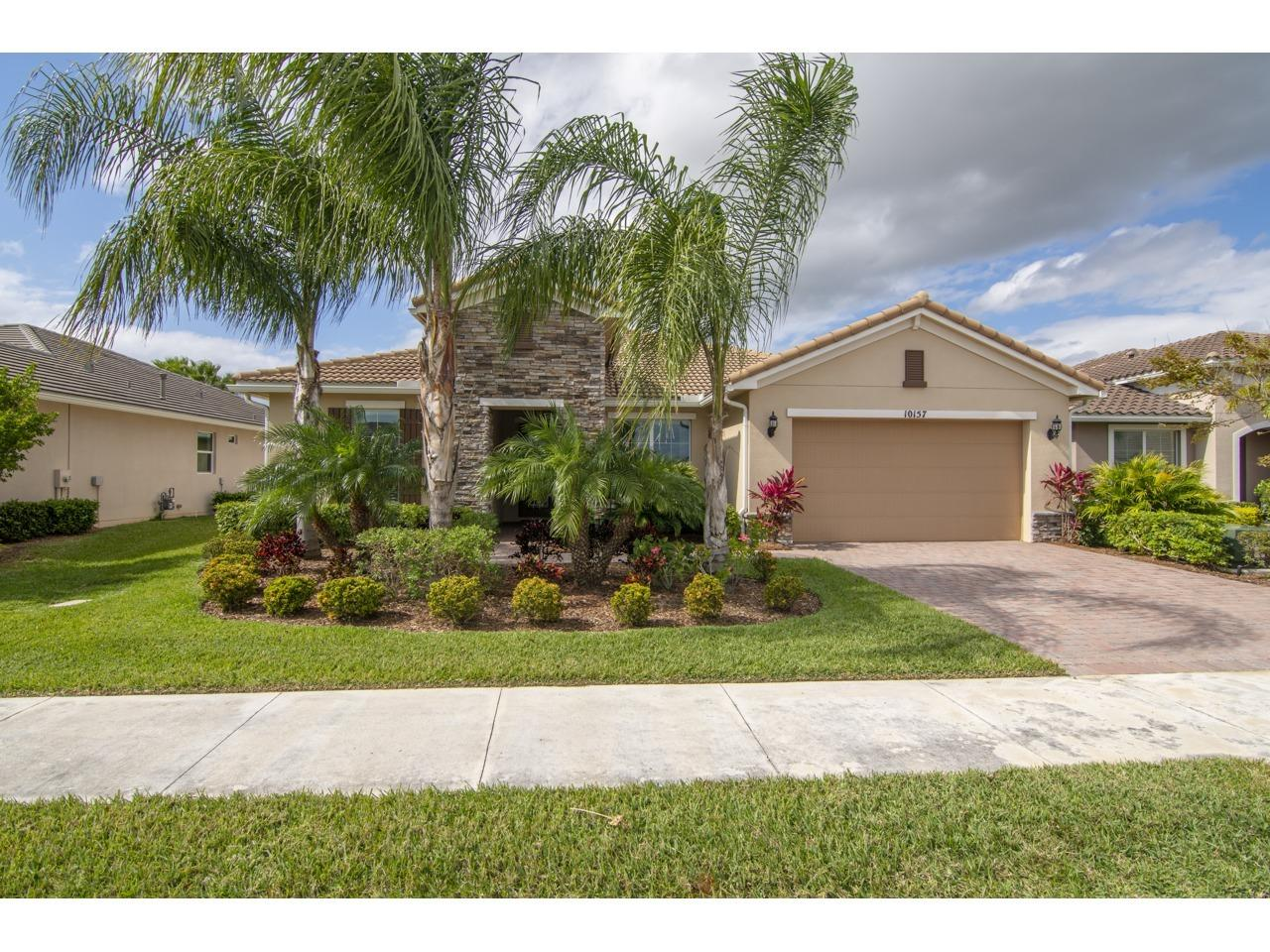 Resort Style Living Palm Coast Model built in 2015. This 4 bedroom, Den, 3 bathroom and Great Room home is in Vitalia at Tradition. The 2481 Living Area Sq. Ft. and 3329 Total Sq. Ft. is selling for only $409,900. Store your toys in the 4 Ft. extended Garage. Home boasts upgrades that include Full House Impact Glass with Triple Sliding Patio Doors to the Lanai. Oversized Master Bedroom has a Huge walk in closet, Gourmet Kitchen with Pantry, Gas option for Range/Oven and Water Heater, 42' Kitchen Cabinets, granite counter tops, 20x20 Tile, Oversized Dining Room has extra windows for additional sunlight. Oversized Screened in Lanai is for those who love to entertain. Additional cabinets in the Laundry Room and Drop Station by the Garage. Start living the Vitalia Resort Lifestyle. Start living the Vitalia Resort Lifestyle that includes Tennis, Bocce Ball, Pickle Ball, Club Rooms, Demo Kitchen, Fire Pits, Live Entertainment at the Grand Ballroom and to many clubs to list. There is a full time Events Coordinator in Vitalia.