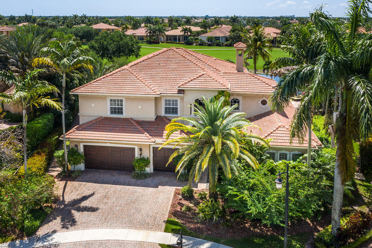 Stunning Expanded Custom Casa del Sol model set on one of the best point lots in all of Mizner Country Club in the coveted Andalucia.  This 5 bed 5 full 2 half bath home has an award winning home theater, 2 story outfitted library and loft, and transitional elements including a striking fireplace, soaring ceilings, 24x24 marble floors, designer lighting, enlarged gourmet kitchen with expansive center island, wine room, coffered ceilings, and a wet bar.  Master bedroom has his/hers outfitted closets, evening bar, and a spacious master bath with his/hers water closets. All beds are ensuite.  Outside is a heated pool, spa, koi pond, artistic landscaping, huge side yard, lake cul de sac lot on the 7th hole. 3.5 car garage. Full Hurricane protection with a Full home generator.  Exquisite Mizner Country Club is an Golf, Tennis, and social membership and equity community with the highest level amenities and service. The highlight is the recently redone Arnold Palmer Signature golf course with green rolling hills and two pro shops with locker facilities.  Enjoy tennis, swimming, fitness and aerobics activities at the cub house.  With multiple dining options and family care facilities the clubhouse is family friendly.   Schedule an event at the grand ballroom.  Mizner Country club is a no tipping club.  Have a martini in the 1 Mile Road Bar before dinner (no reservations needed), and then tantalize your pallet in the Dining Hall.  Renovations on the clubhouse addition will be completed in the Summer of 2019 and will feature an expanded pool, fitness center, amphitheater, a grab and go restaurant and so much more.