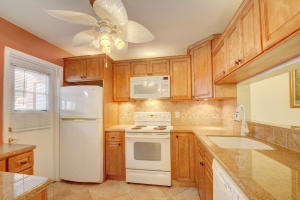 Renovated kitchen, updated cabinets and appliances, peek thru to living room