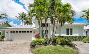 Beautifully landscaped front yard with ample parking. The home exterior features Key West style wood-look concrete, and a 'lifetime' standard seam metal roof