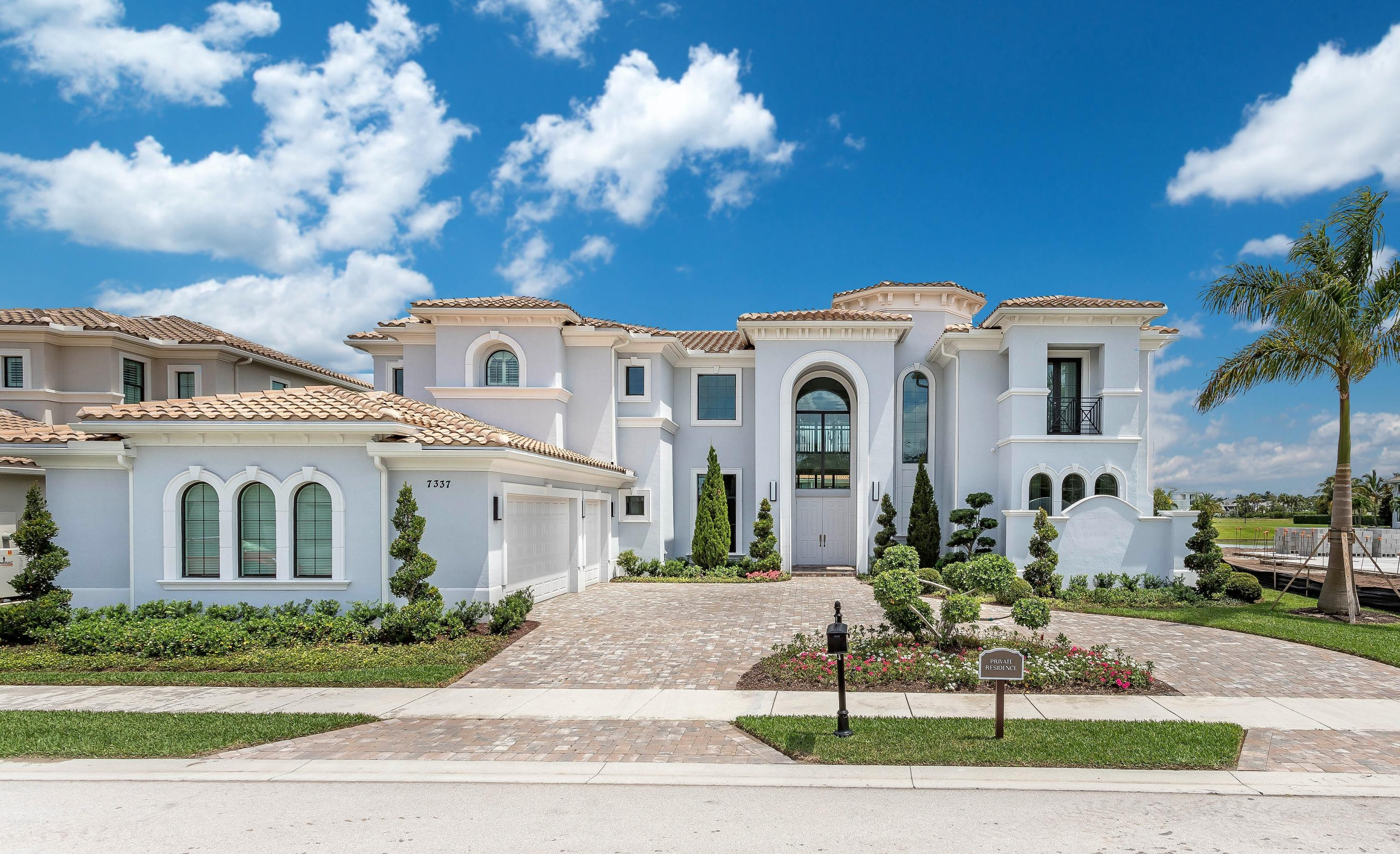 """Exquisite VILLA LAGO MASTERPIECE in the Signature Collection- ROYAL PALM POLO! Move in Ready! $800,000 in upgrades! Built New in 2017- Prime Location with Dramatic Center Lake Views, In the Heart of Boca, Home has beautiful landscaping leading to a covered entry that opens to a two-story foyer, with 48 X 48 Porcelain Tile Flooring, Spectacular Formal Living room, Gorgeous Chandelier, Customer Gas Fireplace with LED lights & wet bar with large Impact Windows looking out the outdoor Oasis, Cover loggia with 24 X 48 Lime Stone & Custom invisible drain, Grass Pool deck, Two outdoor Fireplaces, Custom Pool & Spa, Brand New Summer Kitchen with a beautiful Lake view. The Expansive custom Gourmet Chefs Kitchen with a Large Center Island, Gas Wolf Stove with indoor grill & Sub Zero Appliances! Breakfast area adjacent to the expansive Family room with one of the most amazing Restoration Hardware Chandelier & Custom Gas fireplace with LED lights, two Luxurious Master Suites one on the first floor & one on the Second Floor, First Floor Master Suite has two very Large Walk-in Closets, Morning Bar, Master Bath Has His And Hers water  closets, Large shower & Soak Tub,Upstairs Master has large Setting Area, Morning Bar, Large En-suite Roman Tub, Gorgeous Juliette Balcony over looking the outdoor Oasis, all bedrooms have private en-suites. Home has Private Study/Bonus room/Theater. Impressive State of art Smart Home System """"Control 4"""" running the outdoor lights, Surround Sound inside & Out, Temper Control. Royal Palm Polo has an amazing Clubhouse, Gym, Resort Pool, Tennis Courts."""