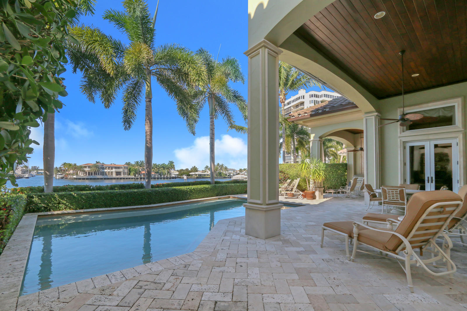 NEWLY PRICED!  BEST VALUE FOR THIS PRISTINE DIRECT INTRACOASTAL AND BEACH ACCESS CUSTOM BUILT ESTATE HOME. Enjoy the incredible views and the ease of carefree living directly on the intracoastal with deeded beach access and a private marina able to dock up to a 50' yacht. Located in the gated seaside enclave of Ocean Cove in prestigious Highland Beach. Stunning custom kitchen designed to excite your culinary senses featuring a center island, Wolf gas cooktop and Subzero refrigerator. The exquisite master suite enjoys spa like dual baths, morning bar, custom walk-in closets, beautiful water vistas and sunset views from your private balcony. Impact doors and windows.   Lushly landscaped patio offers sparkling pool and summer kitchen setting the stage for the ultimate seaside lifestyle. Ocean Cove is perfectly located in Highland Beach and positioned on a 10.5 acre nature preserve. With just 22 European designed estate homes and only 5 waterfront lots this direct intracoastal residence is a rare offering.   Boasting over 5500 square of living space this home features polished Egyptian limestone floors, soaring ceilings, artisan millwork and dramatic wrought iron staircase. Three car garage with Gladiator tile floors, custom built-ins and a workbench.   The resort style backyard features a generous patio, private sparkling pool with swim out shelf and two retractable remote controlled exterior awnings. Summer kitchen complete with BBQ, sink and stainless door storage. A perfect space for added outdoor living, dining alfresco and entertaining.   Custom built entertainment center in great room plus surround sound. Designer Crystal interior lighting. Custom window treatments and painted plantation shutters, extensive exterior precast trim, decorative ceiling moldings and trim throughout and stairway niche finished with antiqued sandblasted mirror. Cut glass wine room door. Stained glass windows in dining room and original oil painted ceiling medallion. Custom closet storag