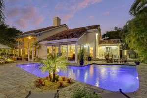 Welcome home to this Custom Estate home with 4.090 square feet. Lushly landscaped.