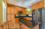 Kitchen cherry wood cabinets and island