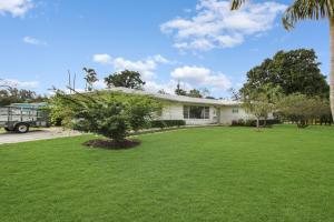 7504 Pine Tree Lane, Lake Clarke Shores, FL 33406