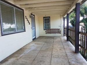 iNVITING COVERED PORCH WITH SWING