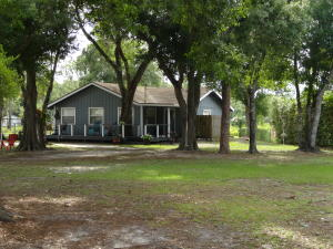 THIS HOME IS SETTING ON A VERY PRIVATE SETTING, YOUR OWN LITTLE PRIVATE HOMESTEAD.