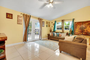 Large and inviting great room with French doors and lots of light!
