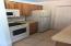 galley kitchen w direct garage door entry.