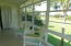 The enclosed porch has a sweeping view--one of the BEST in the complex of pond and golf course