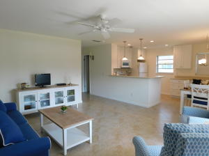 Welcome home! This light and bright, recently remodeled 2nd floor unit features newer tile floors