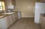Kitchen is small but has everything that the larger kitchens have. Including storage.