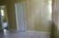 Possible Dining area across from the kitchen and looking toward guest bedroom door on right, Master bedroom door on left is open.