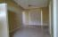 This is the living room looking toward 3rd bedroom on left by slider.