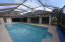 Main living area, family room and Master suite overlooks enclosed pool. Very private.