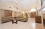 Large formal living room is grand and spacious with 20 foot ceilings. Beautiful gas fireplace.