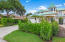 Lushly landscaped home, with large driveway and 2 car garage