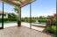 Screened-In Patio Offers Sun Protection and Easy Access to Large Stand-Alone Spa