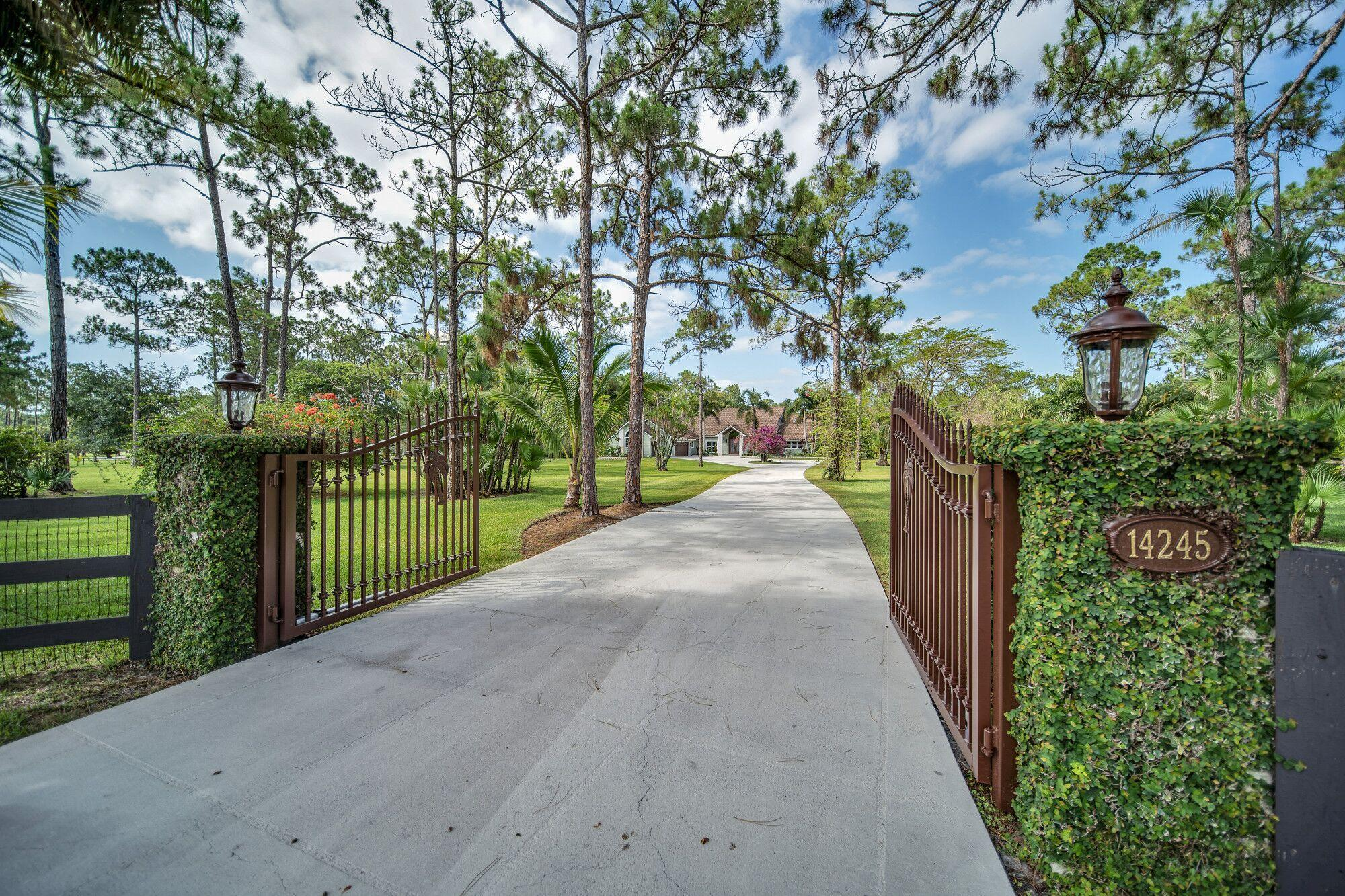 :ALL SIZES APPROX. ELEGANT AND PRIVATE 5 ACRE ESTATE, MIAMI DADE APPROVED CEMENT FIBER SIDING. HARDI PLANK COMPLIES WITH  HIGH VELOCITY HURRICANE ZONE! BEAUTIFULLY MAINTAINED AND MAGNIFICENTLY DESIGNED! UNCOMPROMISING QUALITY AND SUPERIOR WORKMANSHIP. AMAZING PANORAMIC VIEWS FROM NEARLY EVERY ROOM! PREPARED TO BE IMPRESSED BY THIS IMPECCABLY APPOINTED HOME! AS YOU ENTER THE DECORATIVE GATES YOU WILL BE IMMEDIATELY TAKEN BY THIS HORTICULTURE PARK-LIKE SETTING, MATURE FLOWERING TREES ALONG WITH A VARIETY OF SCENIC NATURE WALKS. ELEGANT YET CASUAL, THE DOUBLE ETCHED GLASS FRONT DOORS INVITE YOU INTO THE FOYER THAT PROVIDES A SNEAK PREVIEW OF WHAT THIS HOME OFFERS! FORMAL LIVING ROOM WITH STONE COLUMNS AND STONE FIREPLACE MAKE THIS A PERFECT ROOM TO INVITE COMPANY TO SIT AND VISIT. AS YOU PASS THE BUTLERS PANTRY WHICH OFFERS CUSTOM CABINETRY TO HOLD YOUR STEMWARE AS WELL AS YOUR FAVORITE BOTTLES OF WINE, YOU WILL ENTER THE GOURMET KITCHEN. THE KITCHEN IS A CHEF'S DREAM FEATURING  APPLIANCES, AN ISLAND THAT IS SURE TO BE THE FAVORITE GATHERING PLACE FOR FAMILY AND FRIENDS! CUSTOM CABINETRY GALORE,WINE COOLER, GRANITE, CUSTOM LIGHTING AND A LARGE PICTURE WINDOW OVER THE SINK. THE COZY BREAKFAST AREA LOOKS OUT ONTO YOUR RELAXING BUTTERFLY GARDEN! STONE FIREPLACE AND VAULTED WOOD CEILING ADD TO THE JOY OF THIS SUNNY BREAKFAST AREA. SPACIOUS FAMILY ROOM WITH EXPANSIVE WINDOWS. CUSTOM BUILT IN CABINETRY AND CUSTOM PLANTATION SHUTTERS. FRENCH DOORS WILL LEAD YOU TO YOUR RESORT STYLE POOL, PATIO, SUMMER KITCHEN AND CABANA. SUMMER KITCHEN HAS BEEN DESIGNED TO CAPTURE THE TRUE ESSENCE OF OUTDOOR LIVING! BUILT IN GAS GRILL, SINK,FRIDGE,LOTS OF CABINETS AND COVERED DINING AREA. FULL BATH AND OUT DOOR SHOWER ADD TO THE LUXURY OF THIS OUTDOOR AREA. TOP OF THE LINE IMPACT WINDOWS AND DOORS, ALMOST NEW METAL AND STONE ROOF. EXTENSIVE IRRIGATION SYSTEM, FOUNTAIN IN POND. YOU WILL BE AMAZED AT THE ABUNDANCE OF STORAGE AND CLOSET SPACE THIS HOME HAS TO OFFER! DON'T MISS THIS 4 BEDROOM,5.5 BATH, 3+ GARAGE POOL HOME.The wonderful community of Caloosa is an equestrian community that consists of 350 five acre home sites in Palm Beach Gardens. Fifteen minutes to Fla. Turnpike, 95 and the Gardens mall. Twenty five minutes to downtown West Palm Beach & Palm Beach International Airport. Caloosa's 32 acre horse park makes this neighborhood a real estate gem in Palm Beach County with over 30 miles of interior horse trails. Caloosa's community amenities include: dressage arena, a riding arena, jump course and a cross country area. Multiple tennis courts, children's playground, basketball courts and a barbecue area, community meeting room and restrooms. The private park is for the exclusive use of Caloosa residents and their guests. Caloosa residents enjoy events such as movie nights, chili cook offs, barbecues, holiday parades, benefit rides, demonstrations, and horse shows.