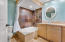 Travertine counter tops and garden tub/shower enclosure