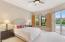 Large master suite offers large windows and double sliders