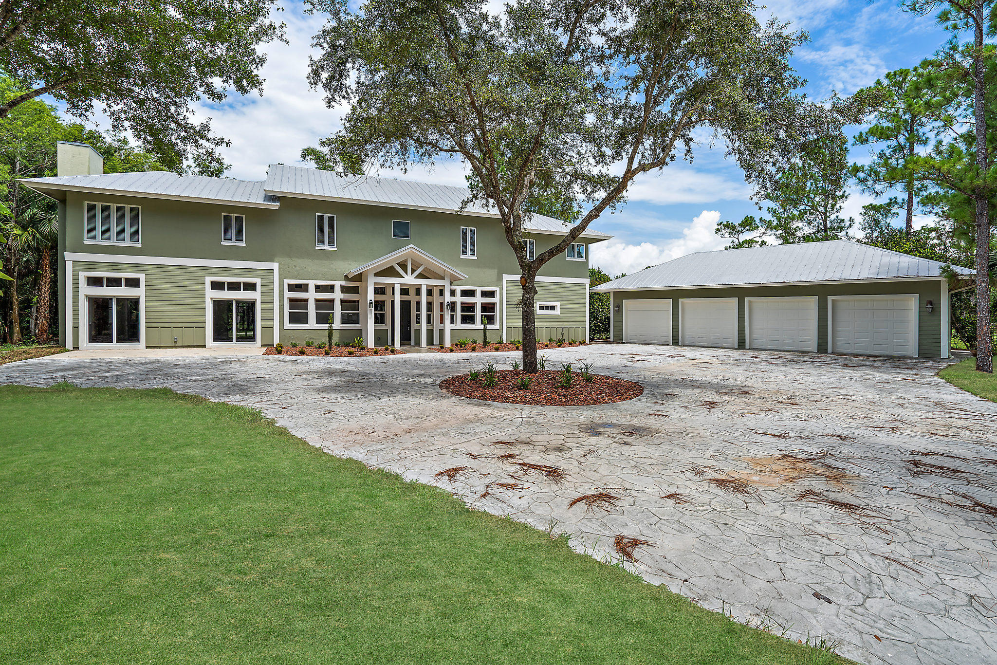 Wow! Welcome to Jupiter Farms living at its finest! ONE OF A KIND 5 Bedroom, 5-1/2 Bath PLUS BONUS 3rd floor LOFT & Detached 4 car garage & workroom situated on just over 3.76 acres of prime land! Built in 2003, CBS foundation and fully remodeled in 2019 with over $200,000 worth of upgrades, it has all the luxuries of a new home that you deserve. From PGT hurricane impact glass windows on 2nd floor, authentic wood floors, PebbleTech pool & spa, metal roof, authentic fireplace, huge walk in closets, fresh paint inside and out, landscaping featuring natural and indigenous plants throughout and many classic craftsman features to keep the living environment ''Country modern''. This home is unlike any other in the Jupiter Farms area. It gives way to bright and inviting living spaces throughout, great layout and well thought out planning. Enjoy the gourmet kitchen with stainless appliances that is socially inviting and open to the dining area & family room, features that are great for family time and entertaining. An elegant and oversized master bedroom/bathroom suite, with view of your very own private pond where a Florida otter has made himself at home as well! The expansive secondary bedrooms give this home more of its character and luxury, including a mother in law suite with secondary laundry room. With plenty of upgrades throughout, and over 5,258 total sq ft (3,589 sq ft of living area) this home is set for the most discerning buyer. A MUST SEE!