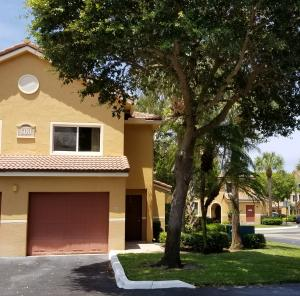 Beautifully Remodeled * Corner * Townhome in Intracoastal community! Remodeled kitchen, stainless, granite, 2 large bedrooms, half bath, 1 car garage & covered patio!