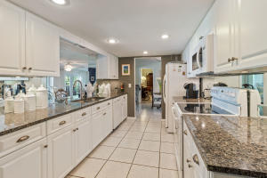 Kitchen with Granite Counters and Mirrored Back Splash