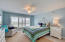 Completely remodeled guest bedroom with white wood-look laminte flooring and stunning views of the intracoastal and Lake Wyman