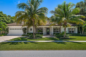 Beautifully located in gated North Palm Beach enclave