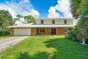 Meticulous Acreage home on over 1 acre , fully fenced.