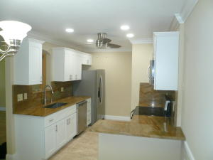 NEW APPLIANCES, ALL WOOD EZ GLIDE DRAWERS AND CABINETS, GRANITE COUNTER TOPS, NEW LIGHTING AND PLUMBING