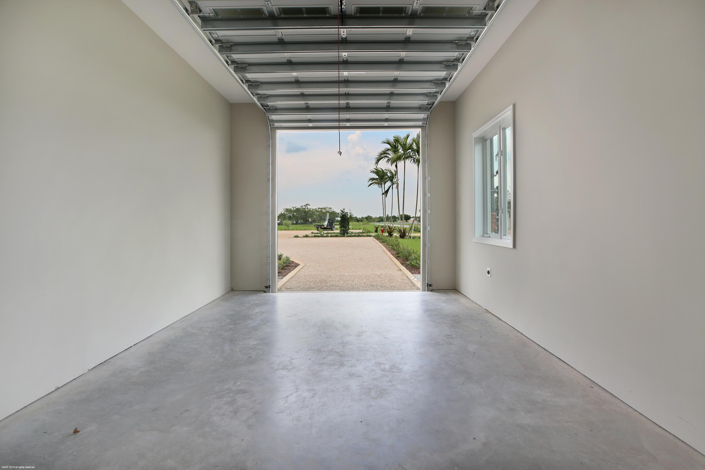 1 of 2 - attached one car garage bays
