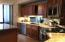 Cherry wood island kitchen with upgraded granite; pull out drawers with soft close cabinets.