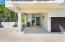 Rare end courtyard unit offers a one car garage, one car carport, plus extra parking.