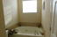 Jetted soaker tub with privacy window above