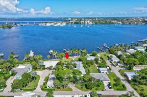 Riverfront Estate Home with beautiful South East esposure! Beautiful breezes, looking out to the Roosevelt Bridge and Sailors Return Marina!