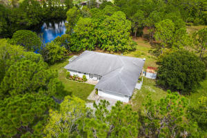 Over 7 acres of private fenced in property with large pond