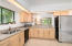 Renovated Kitchen with stainless appliances, granite counters. Opens to Greatroom