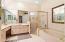 master bath w/ dual sinks and soaking tub