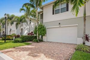 1044 Piccadilly St located in Hampton Cay in the Heart of Palm Beach Gardens!