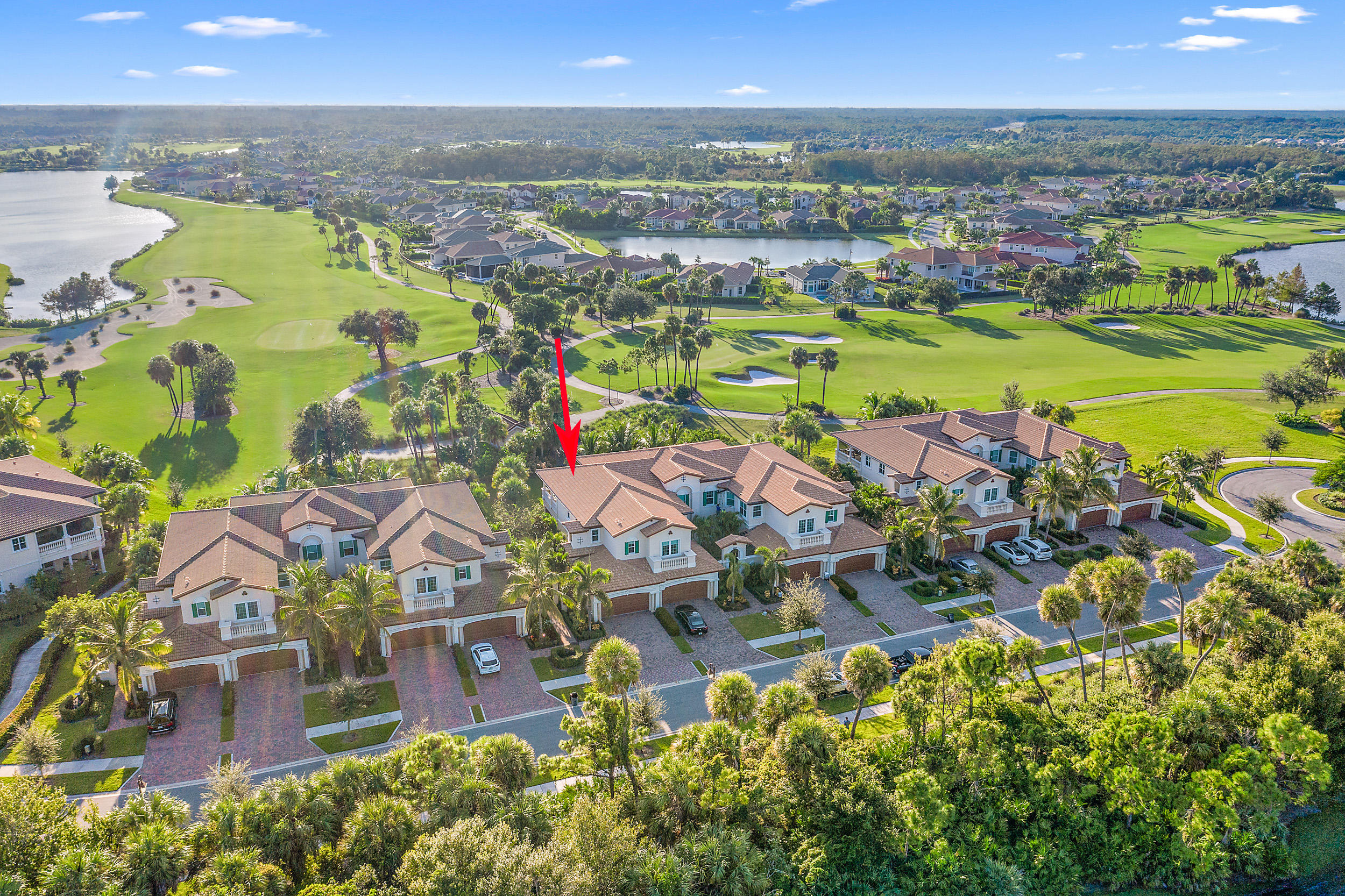 Look no further! This is the GORGEOUS, turnkey South Florida designer home that you have been searching for! Situated toward the end of a cul de sac and overlooking the 7th & 8th holes of the 18-hole Greg Norman Signature golf course of the esteemed Jupiter Country Club, 191 Tresana #157 will blow you away from the moment you enter the front door!The current owner of this magnificent home is an acclaimed interior designer and her professional touch can be felt throughout the entire home with no expenses spared and no spaces overlooked. Featuring beautiful moldings, exquisite ceramic tile flooring (laid on a diagonal), custom window treatments, designer wallpaper, and spectacular light fixtures throughout, this home has been finished to perfection [CLICK TO CONTINUE READING] and is waiting for its new owner. 191 Tresana #157 is a highly sought after, second floor Genova model, which are known for their three full bedrooms and three full bathrooms, PLUS formal dining room, PLUS den or formal living room, and with large wrap around porches. The owner of this Genova model customized her unit with a few unique floor plan modifications that one must see to appreciate, creating more functional living space, without compromising elegance, and truly making this residence one of a kind! Walk up the property's lushly landscaped pathway and immediately feel at home as you enter this divine home. High ceilings, a gorgeous staircase, two-car garage, and a functional (upgraded) elevator greet you on the ground level, while the home's elegant entry and sitting room (could be converted to an office) await at the top of the stairs. The upper level is home to the main living spaces with a functional, open floor plan anchored by a large chef's kitchen -- gas-stove, stainless steel appliances, granite countertops and gorgeous espresso cabinets -- and a formal dining room which is large enough to seat 10 comfortably! The expansive wrap around balcony can be conveniently accessed from two areas within the main living space - from the kitchen or the living room, providing the perfect flow for entertaining! Enjoy Florida's finest cotton-candy sunsets from your private balcony overlooking the tranquil golf course, sipping your wine and living your best #Juplife. Both of your new guest bedrooms are generous in size and are on opposite ends of the home, separated from the master bedroom suite - providing perfect privacy and a true split floor plan. With ample storage throughout the home, including a large two-car garage with built-in storage, a large under-staircase hidden closet, and a large laundry room, this home truly has it all! Whether you travel frequently, are purchasing a second home, or are looking for a turnkey home, 191 Tresana #157 is the low maintenance, ready-to-move-in solution for you! Uniquely located off the ONLY exit where both Florida's Turnpike and I95 meet, Jupiter Country Club is a short drive to Palm Beach International Airport, and both Fort Lauderdale and Miami's airports are within 60 and 90 minutes, respectively. Jupiter Country Club is a world-class country club with state-of-the-art amenities and a Signature Greg Norman 18-hole golf course. Featuring (2) resort style pools, (6) Har-Tru tennis courts, bocce ball, formal and casual dining options, a modern fitness center, and a fully stocked golf proshop. 191 Tresana Boulevard is situated in the most PERFECT location - close to where I95 and the Florida Turnpike meet, as well as being just a short drive from the pristine Jupiter beaches, world class shopping, and fine dining of the Palm Beaches, A-rated schools, and a blossoming life sciences & engineering industry. Don't miss the opportunity to live in this Jupiter Country Club masterpiece. Schedule your showing today!