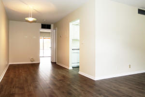 NEW WOOD LAMINATE Floors & freshly painted. View from front to dining area