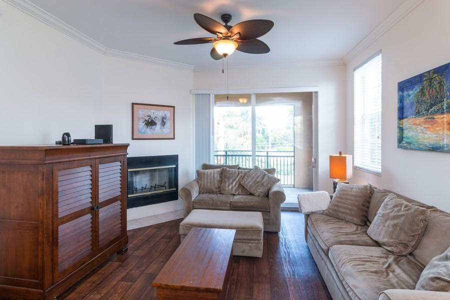 Great opportunity to own a 3 bedroom, 2 bathroom CORNER unit in St. Andrews with a garage!!  This condo is tastefully furnished and is being offered fully furnished!  This is an income producing rental.  It has been rented annually the past two years for $33,600 annually and prior to that was rented seasonally for $5,000 month ($20,000) and off-seasonally for $1,500 a month!!  Currently rented through June 30th, 2020 which means you make immediate income!  Ac unit was replaced in June of 2016.  St. Andrews offers resort style amenities.  This gated community has a beautiful pool, gym, sauna, and community center.  Centrally located on the corner of Forest Hill and South Shore Blvd, it only takes moments to get to any of your favorite equestrian events, tennis, golf, shopping and restaurants.  Only 20-25 minutes into West Palm Beach, to Palm Beach International airport, PGA blvd, etc... You never have to worry about parking during high season or summer weather with your one car garage.  The corner unit adds extra natural light and square footage than interior units.  Don't miss out on this opportunity.