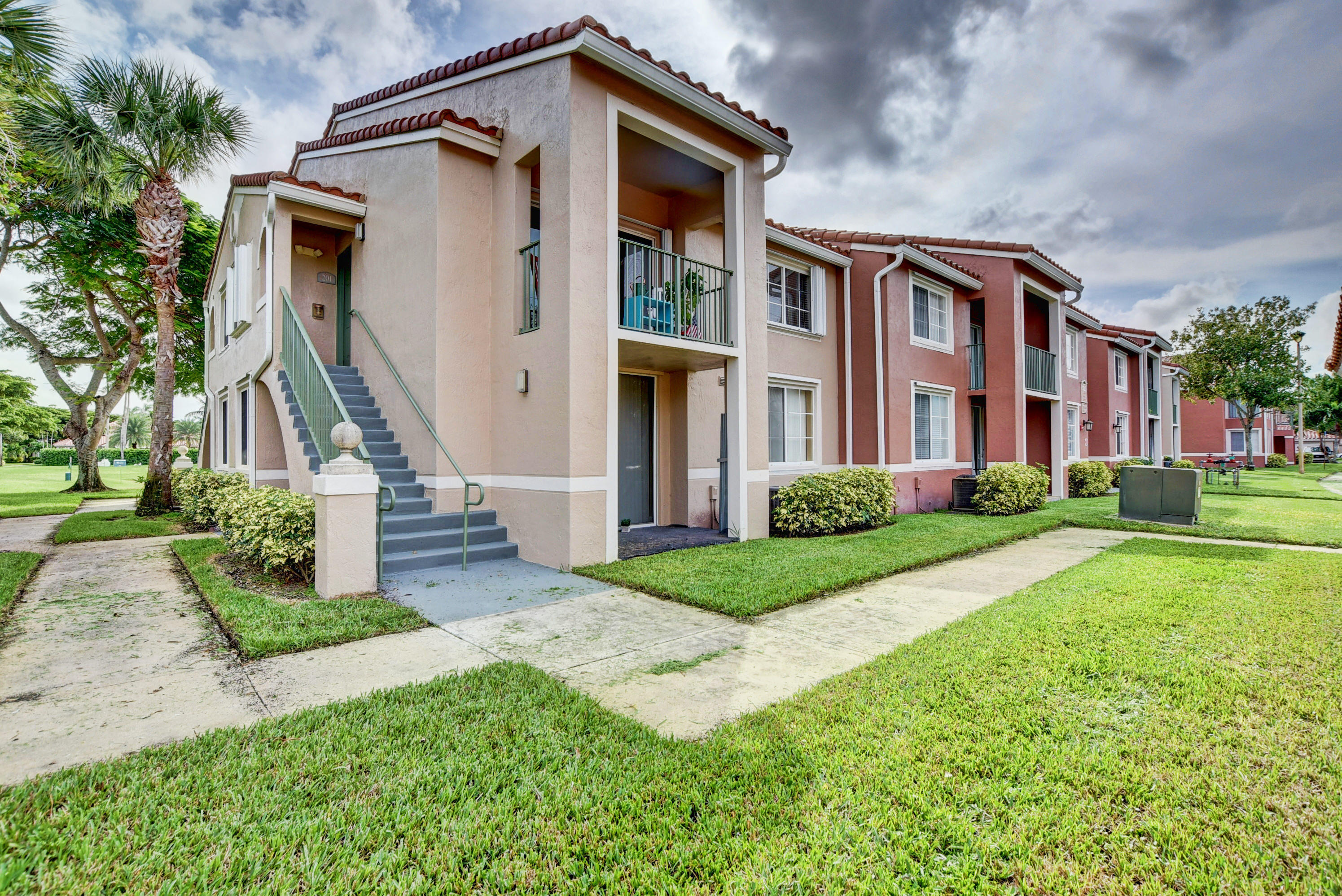Great value for a 1/1 2nd floor corner unit in beautiful St. Andrews at Boynton Beach.  Move-in ready. New A/C.  Garage available for $100 per month and there is one assigned parking spot and plenty of guest parking. Maintenance Fee includes basic cable, water, roof maintenance, landscaping and trash removal. For investors: Can rent immediately!