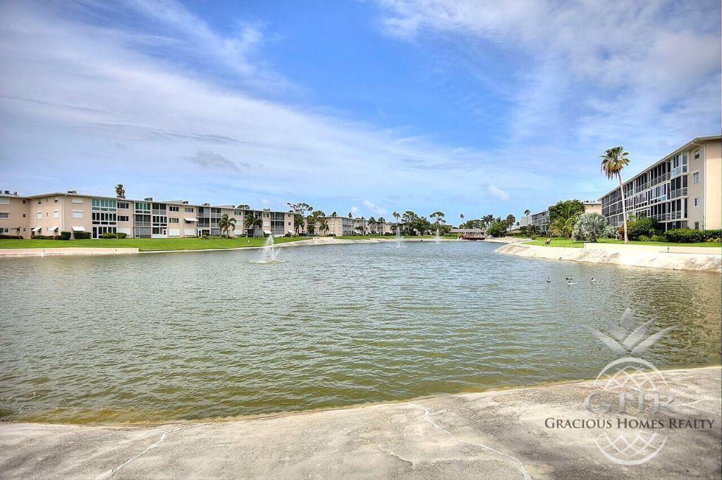 Convertible corner unit with hurricane awnings, new wood laminate floors thru out, new paint, new hot water heater, new faucets in bathroom and new lights in the kitchen.Huge patio for entertaining and evening breezes.